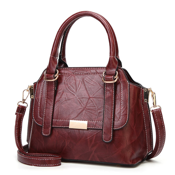 Hand-Held Oblique Leather Handbag