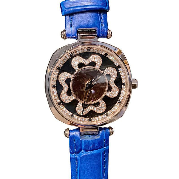 Trendinggate.com DACRNew fashion trend leather strap with four-leaf clover runs dial crystal face watch Korean version