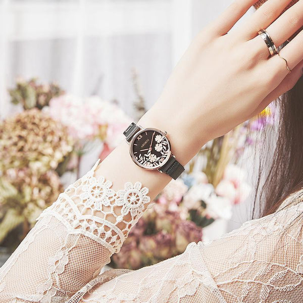 Trendinggate.com Rose shell black surface black belt French minority watch lady simple temperament waterproof fashion light extravagant female student Korean version of ins wind 2019 new model