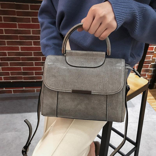 Trendinggate.com gray Guangzhou manufacturers wholesale Korean style 2019 new leather women's bag oil wax cow leather fashion versatile handbag trend