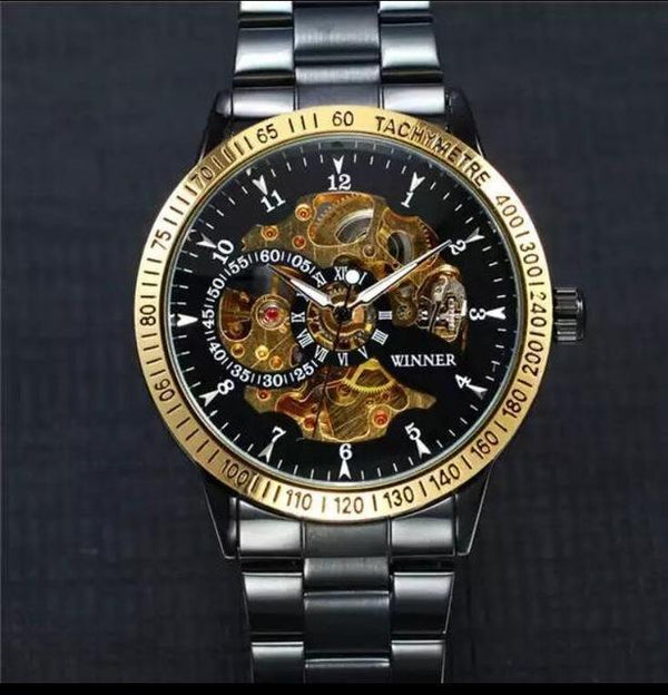 Trendinggate.com Men's Watches Black steel belt gold shell black face gold machine T-WINNER silver band creates a precious design and a touch of class