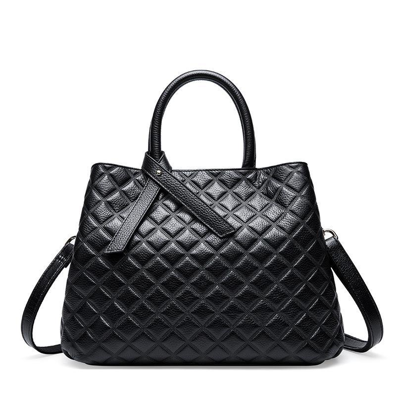 Trendinggate.com Black The new autumn and winter handheld large capacity women's bag with one shoulder slanted large bag and one shoulder bag with a large shoulder in the first layer of cowhide rhombus women's bag in autumn and winter.
