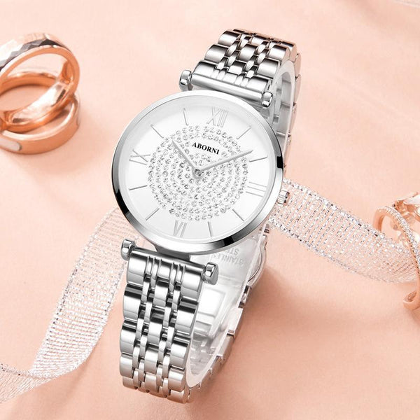 Trendinggate.com White-faced steel strip with silver shell Ultra-thin Quartz Star Watch with Star Trend Woman Watch with Diamond Star Trend Wholesale Customized Logo