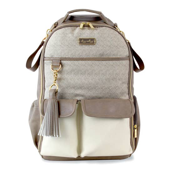 Itzy Ritzy Boss brand diaper bag in tan and cream herringbone pattern