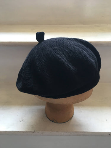 Black Cotton Knitted French Style Beret with Tab at Top and Rolled Hem, by Lord and Taft