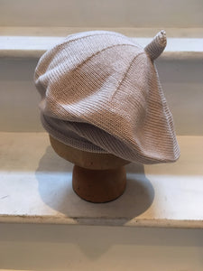 Side View of Lord and Taft beige knitted cotton beret