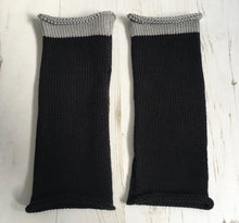 Load image into Gallery viewer, Flat Lay of Black Cotton Knitted Wrist Warmers with Grey Trim