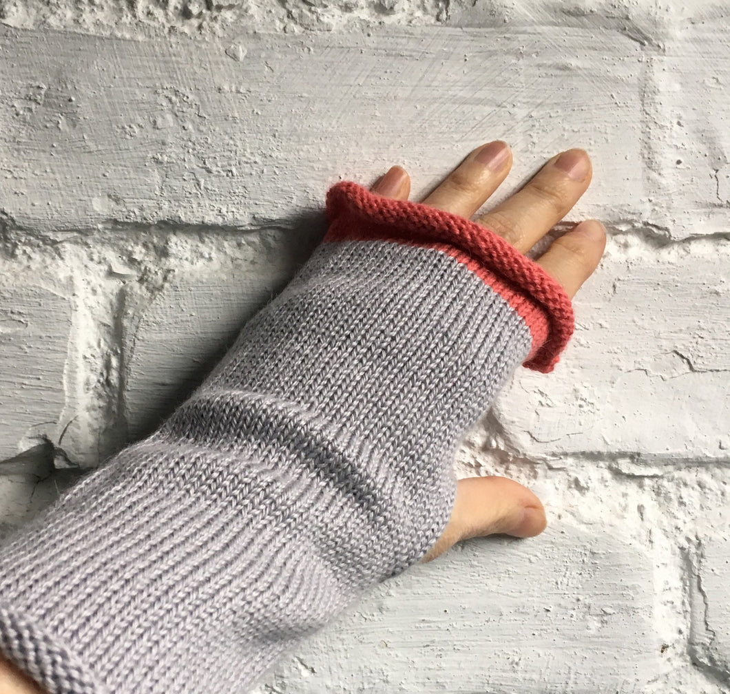 pale grey alpaca and silk blend fingerless gloves with pink trim at fingertips and slit for thumb. by Lord and Taft