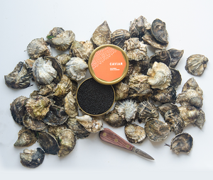 pile of Island Creek Oysters with open 250g tin of caviar on top