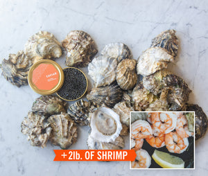 a pile of oysters with an open caviar tin on top, small box with shrimp pictured in corner