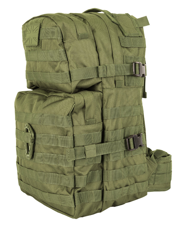 front image of medium sized olive green  backpack with 2 front compartments. velcro panels are across the top and molle attachments across the bottom one. 2 side compession straps also visible