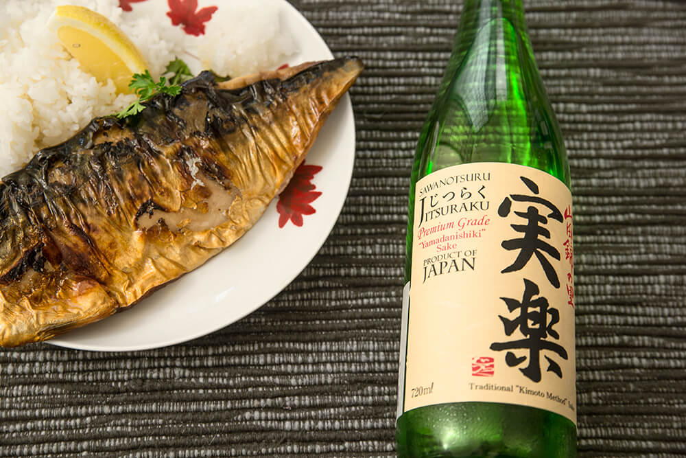 A bottle of rice wine and grilled mackerel