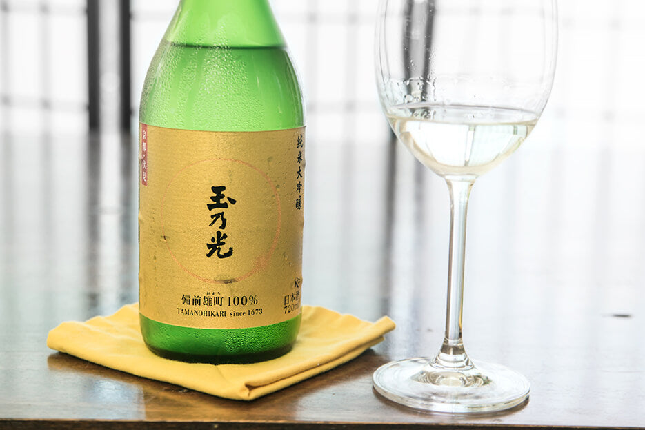 a bottle of Kyoto sake and a wine glass