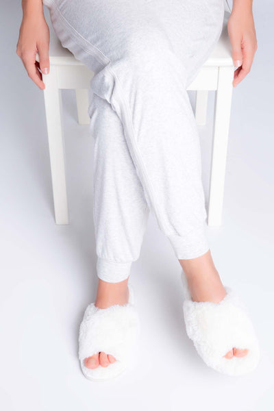 Ivory faux fur slippers with cross-over straps, plush foot bed and molded outsole. (4881839915108)