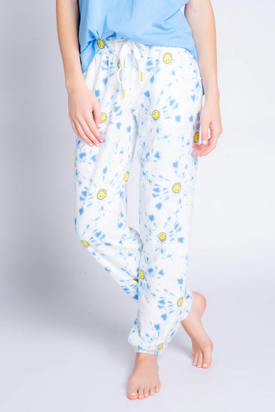 Banded pant in in blue tie-dye with yellow smiley print. Side pockets, relaxed fit. (4881845190756)