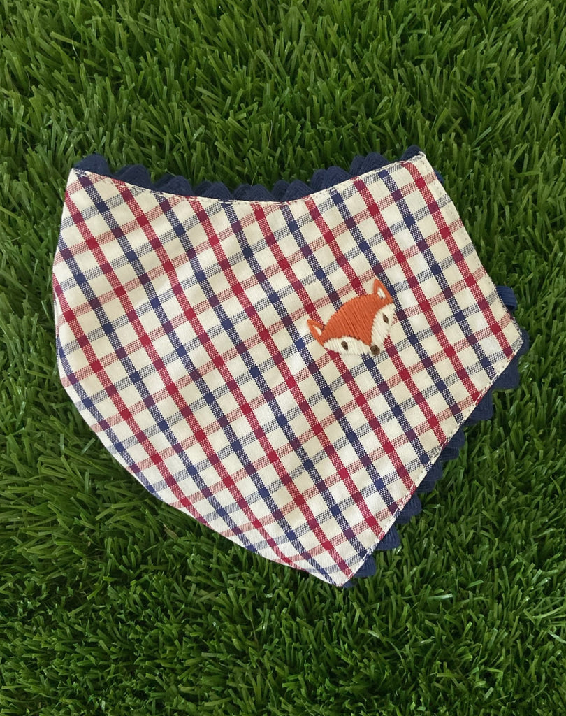 child mask with red and blue plaid and fox