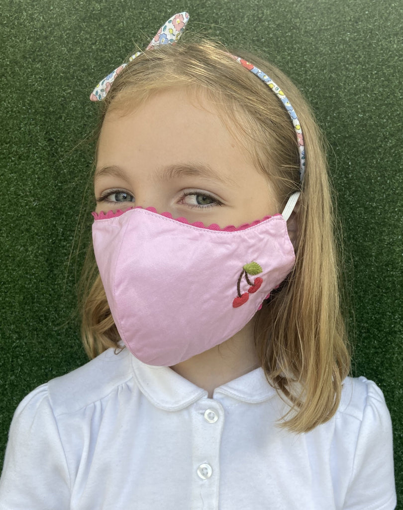 Child mask pink with cherry.
