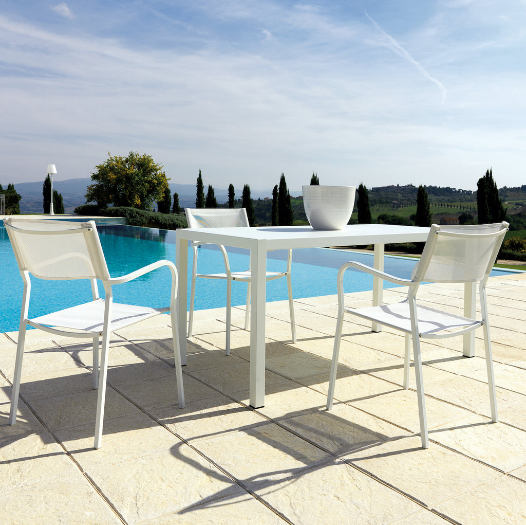 white metal outdoor table and chairs