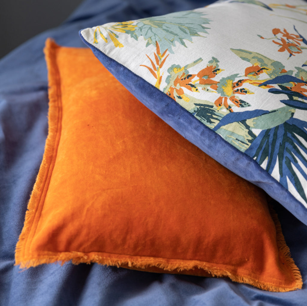 orange velvet cushion with fringe edges by Vivaraise