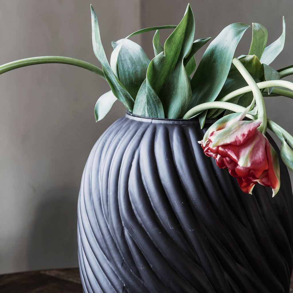 dark brown glass vase with a swirl texture