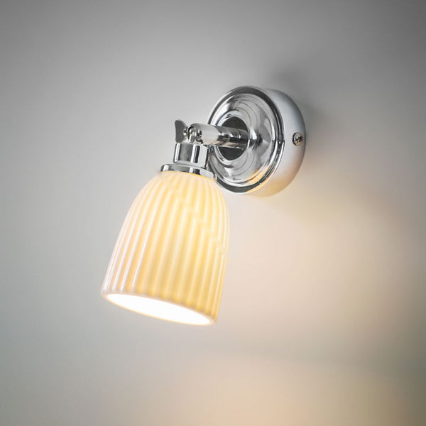 Alma bathroom wall light with a white ceramic shade