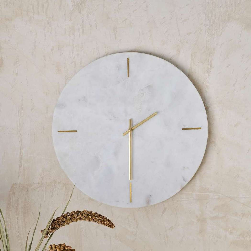 white marble clock with brass hands by nuke