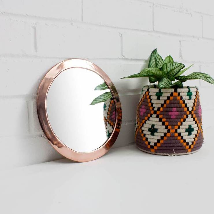 small rose gold round mirror