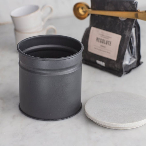 grey storage canister with marble lid