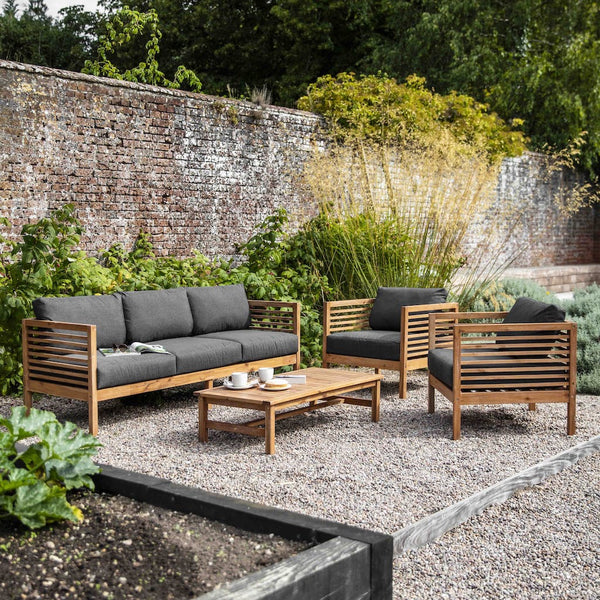 Cadgwith outdoor sofa set in wood with dark grey cushions