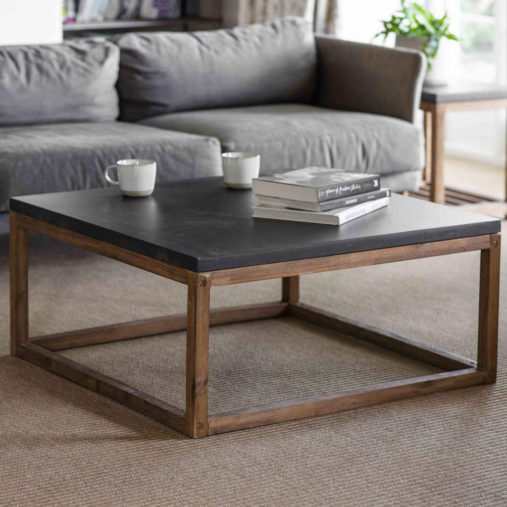 chilson coffee table with wood legs and cement top