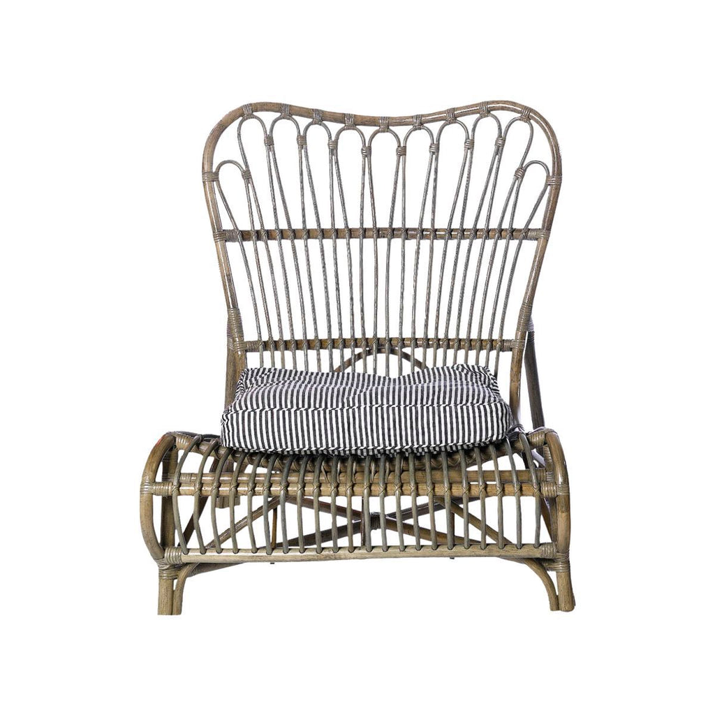 rattan lounge chair in natural