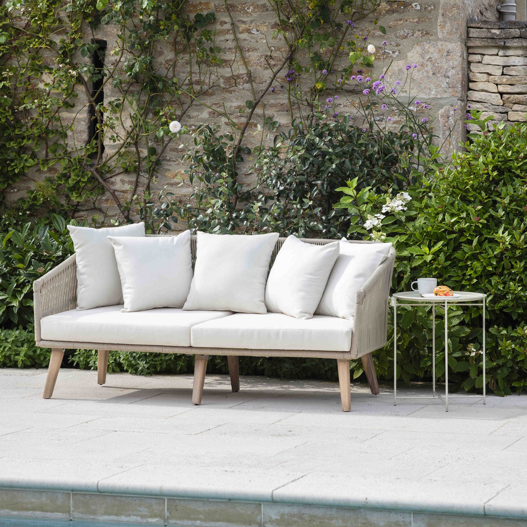 Colwell outdoor sofa by Garden Trading with white cushions