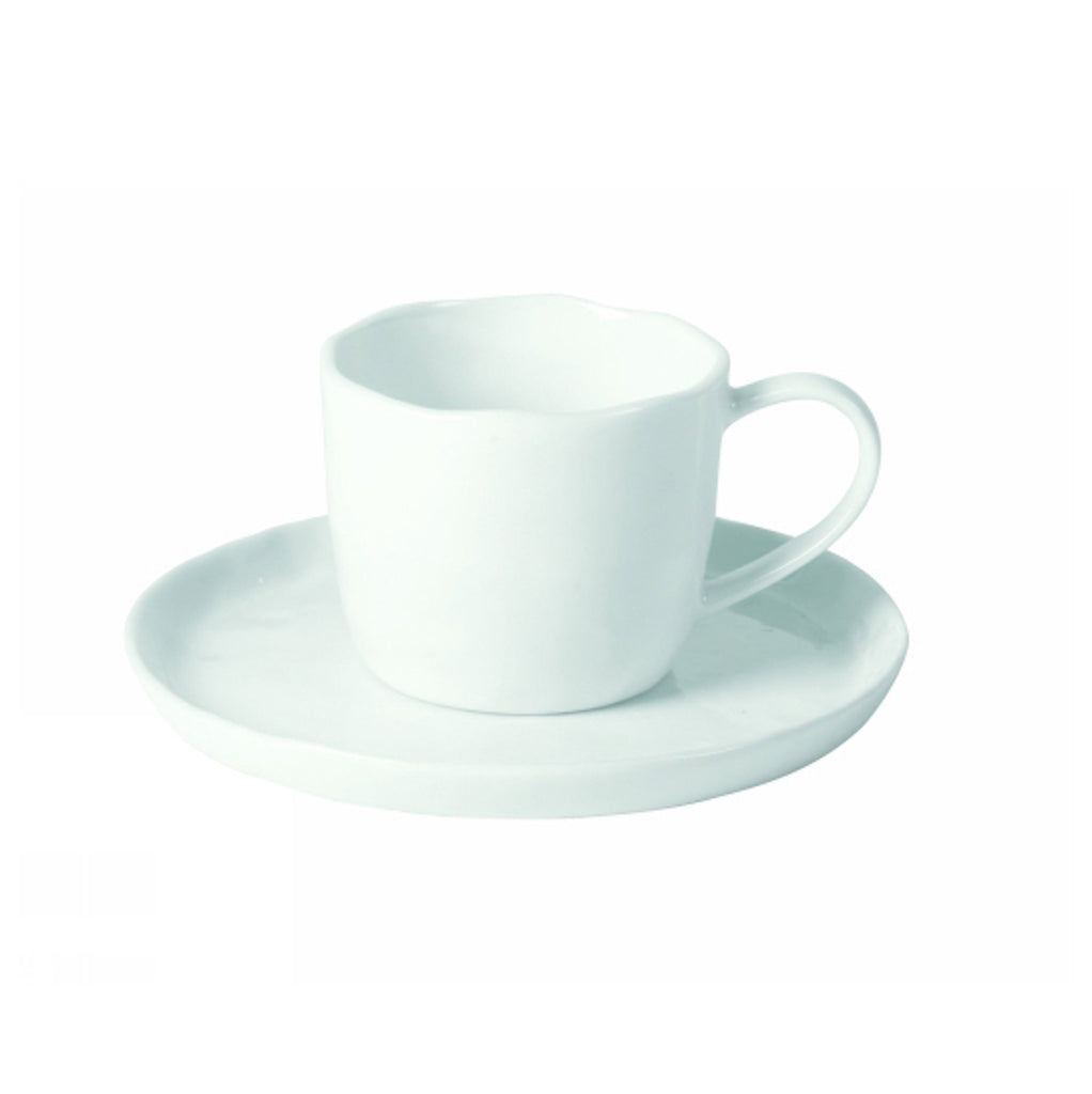 white porcelain teacup and saucer