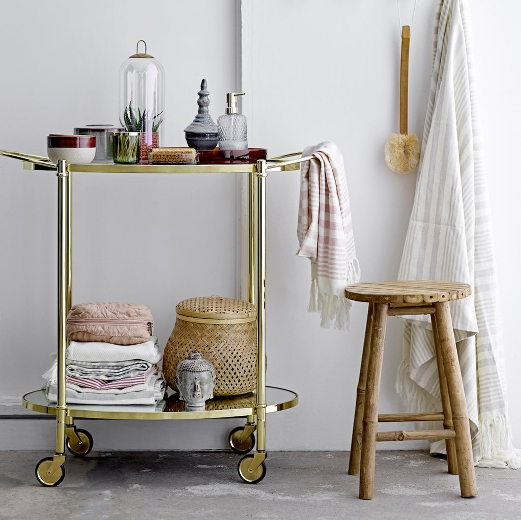gold drinks trolley with glass shelves by Bloomingville