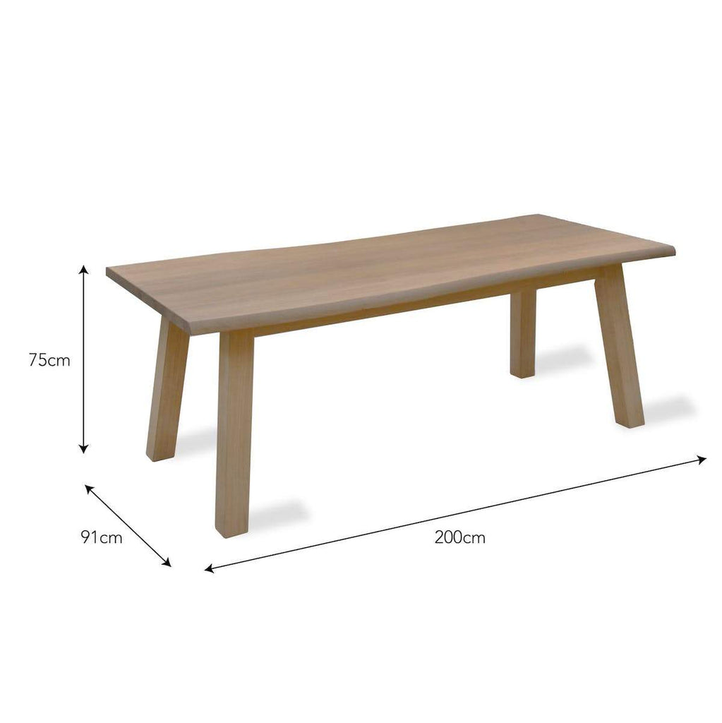 Oak dining table with organic shape