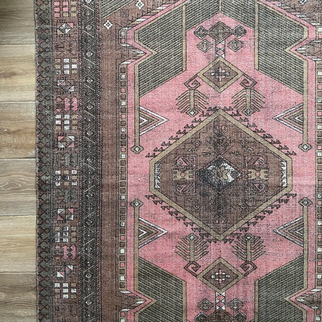persian style rug in pink and brown