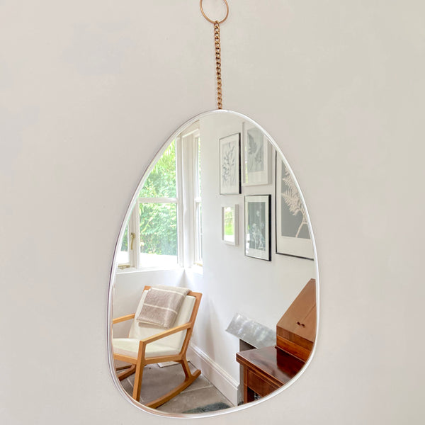 pebble shaped mirror with brass chain