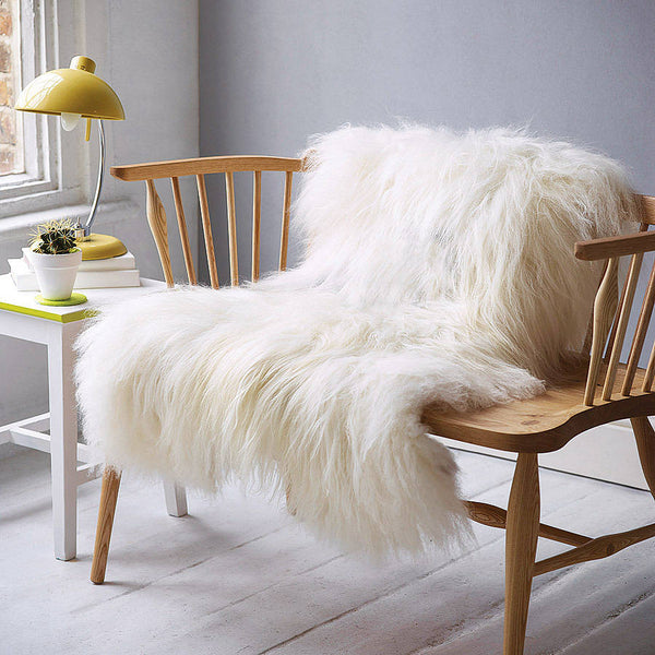 white Icelandic sheepskin rug on bench