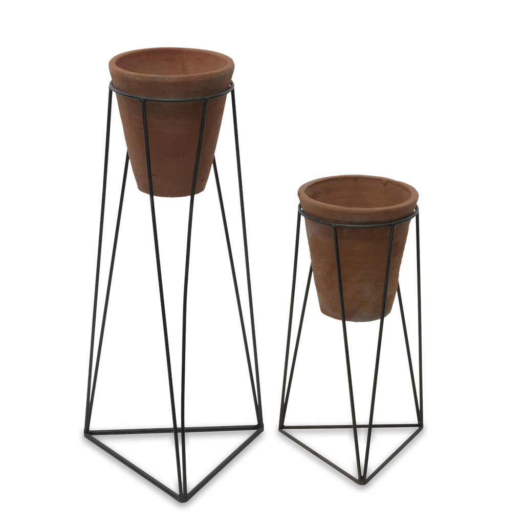 terracotta plant pot on zinc plant stand by Nkuku