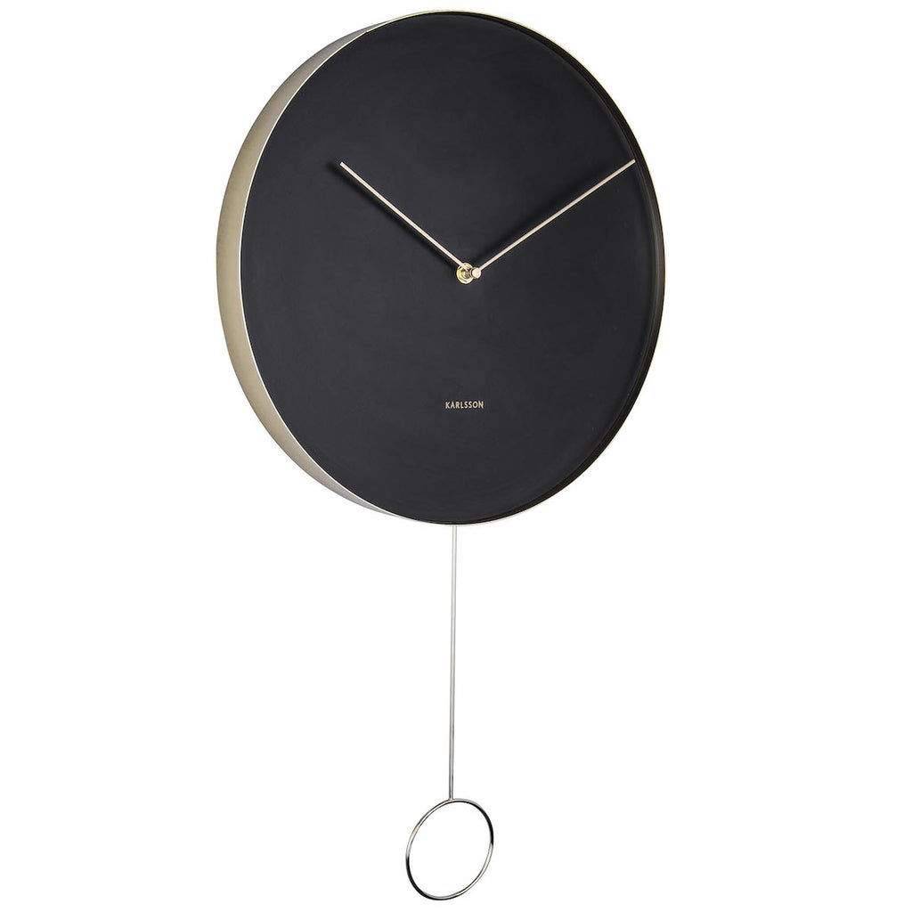 Black clock with brass hands and pendulum by Karlsson