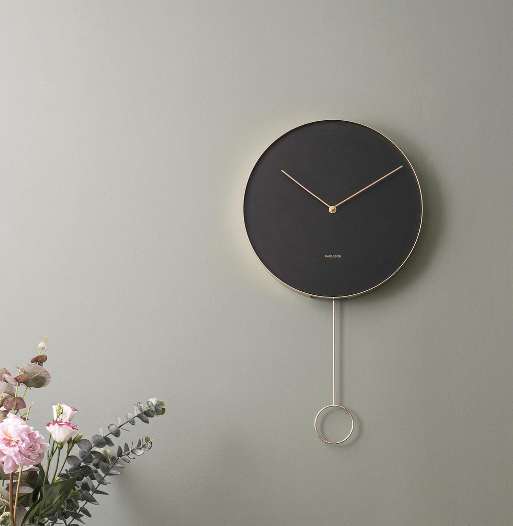 Black pendulum clock by Karlsson