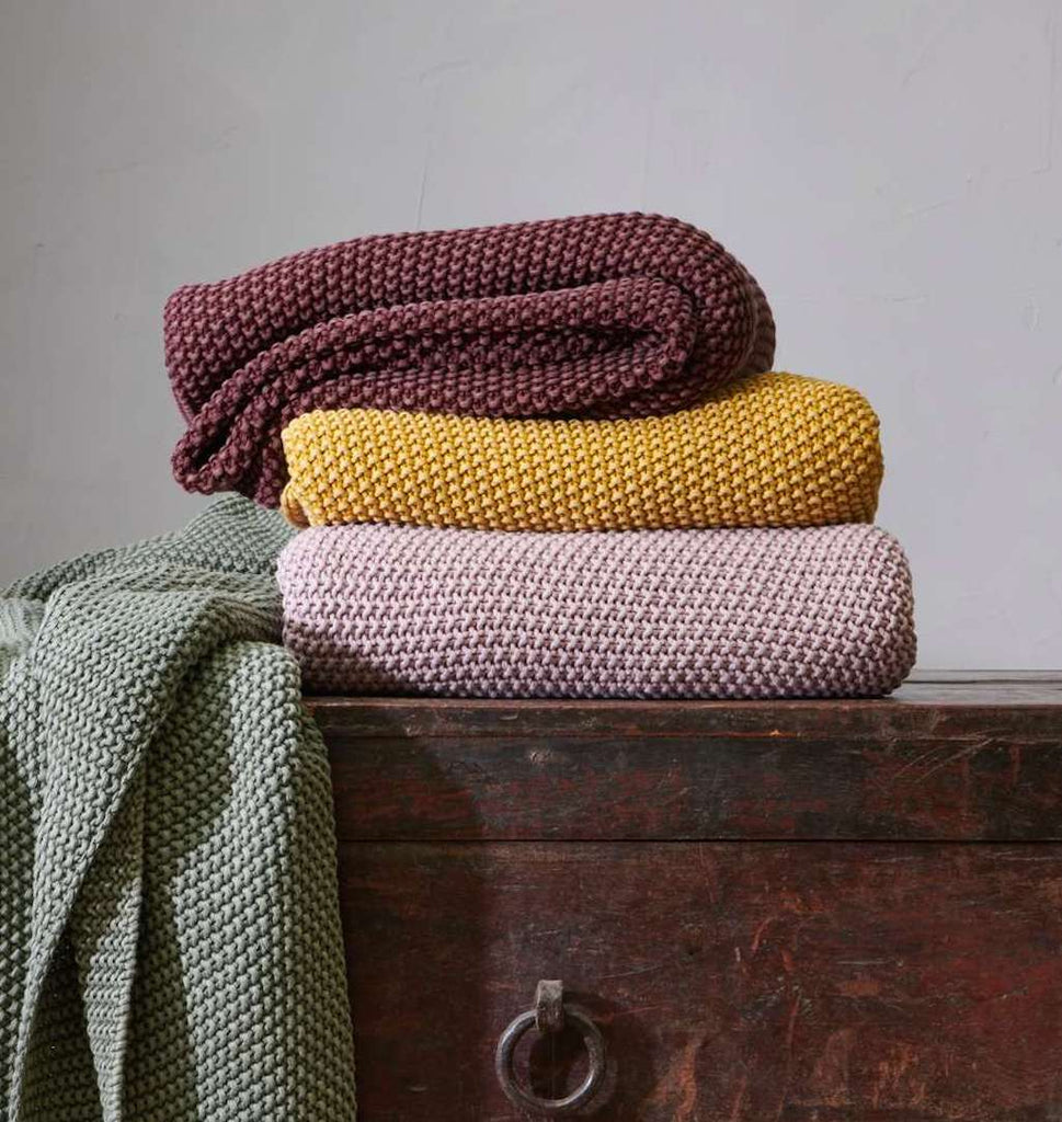 Nkuku moss stitch throws in pink, mustard and berry