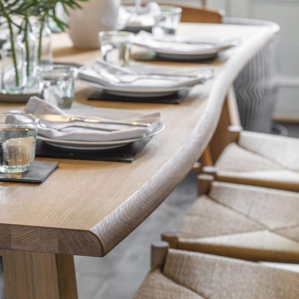 Oak dining table with curved edge