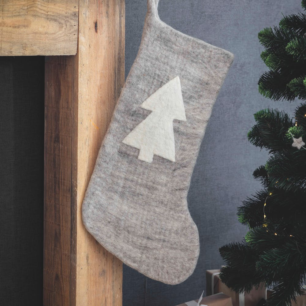 grey felt Christmas stocking with white tree