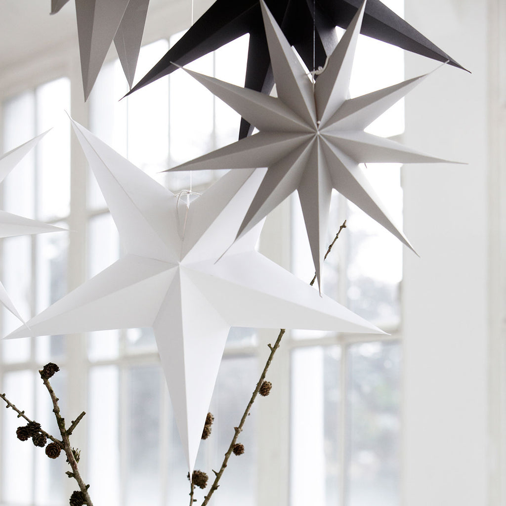 Hanging paper stars by House Doctor