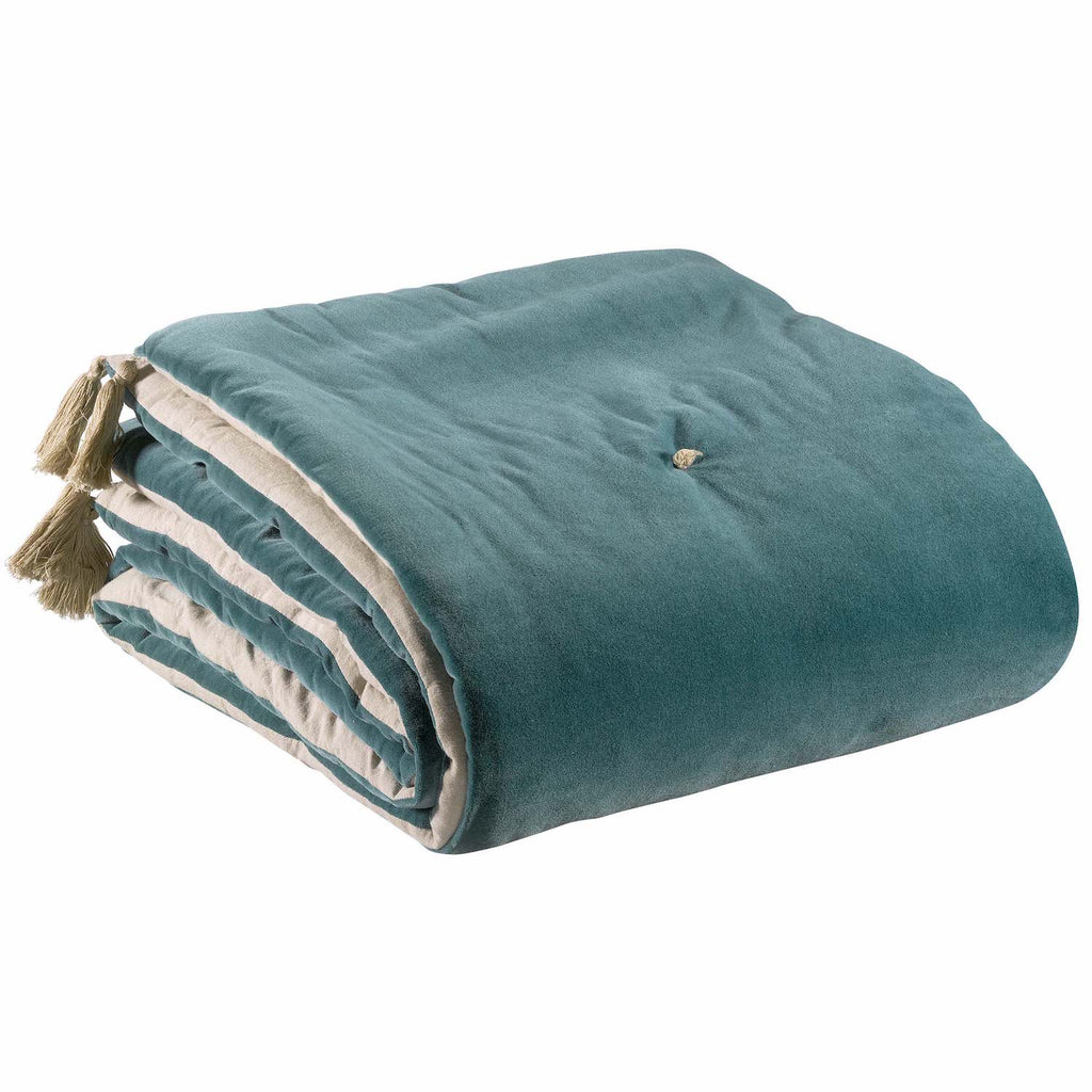 Green velvet throw with tassels