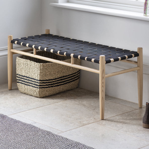 black hallway bench with woven seat