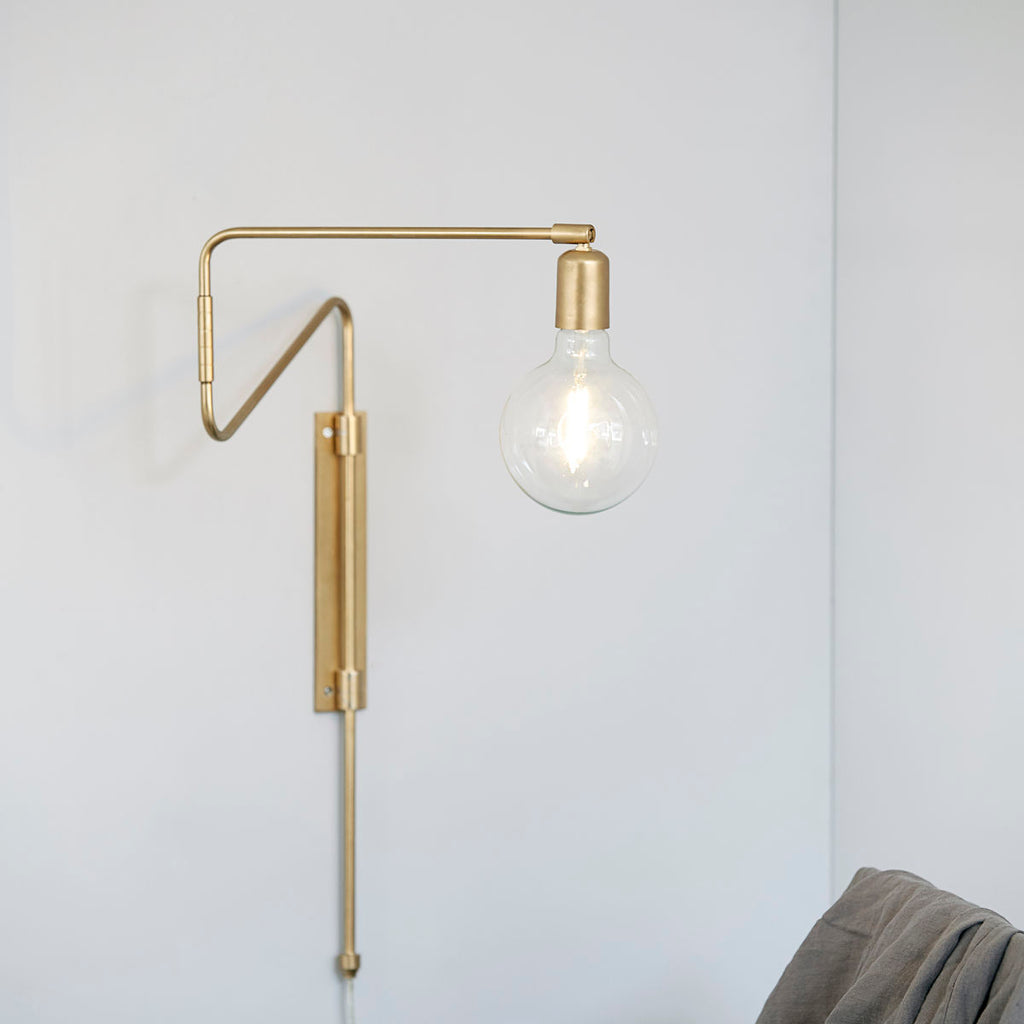swing arm brass wall lamp