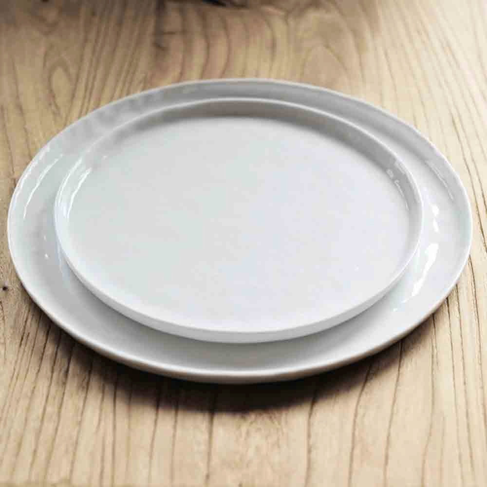 white plates with a rustic mottled finish