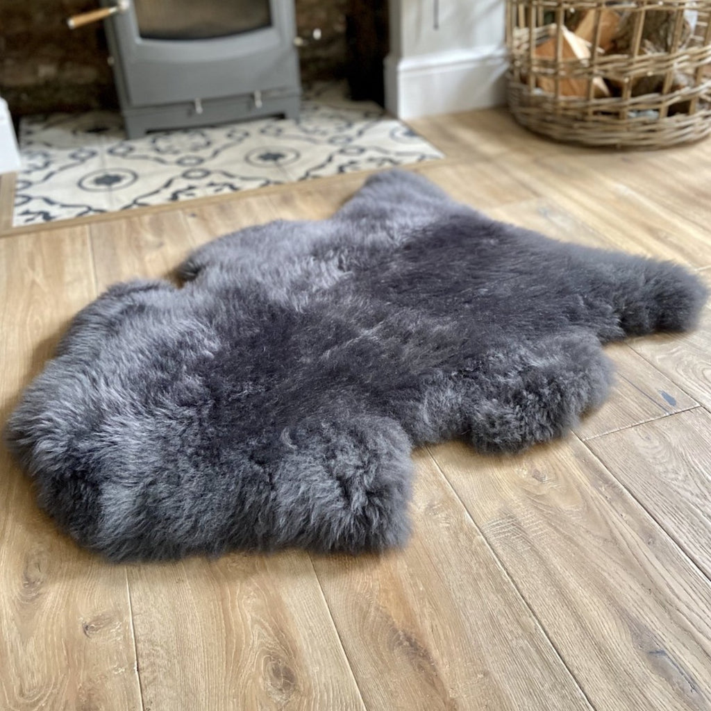 large dark grey sheepskin rug